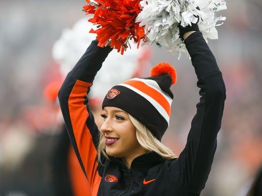 Oregon State cheerleaders enter the field for a game against Arizona State on Saturday, Nov. 18, 2017, at Reser Stadium in Corvallis, Ore. Arizona State won the game 40-24.