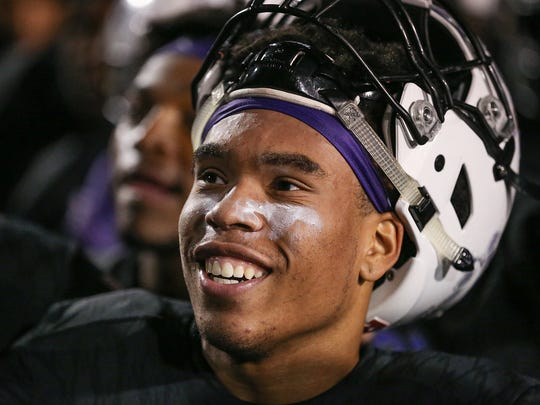 Ben Davis quarterback Reese Taylor (2) listens to coach Mike Kirschner after the Giants defeated Warren Central, Nov. 3, 2017. Ben Davis clinched the sectional title, 36-29.
