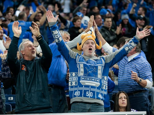 Lions fans celebrate a touchdown at the end of the first half against the Vikings during the Thanksgiving Day game Nov. 23.