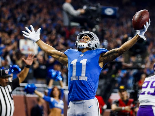 Lions receiver Marvin Jones celebrates his touchdown in the second half against the Vikings at Ford Field, Thursday, Nov. 23, 2017.