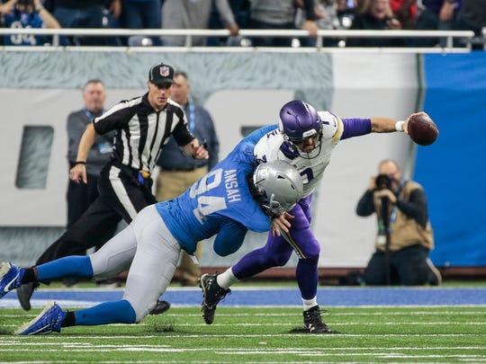 Lions defensive end Ziggy Ansah sacks Vikings quarterback Case Keenum in the second half at Ford Field, Thursday, Nov. 23, 2017.