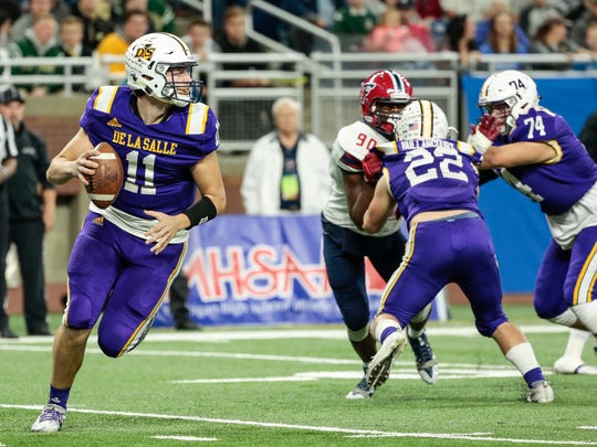Warren De La Salle quarterback Luke Pfromm (11) looks before making a pass during the first half of the MHSAA Division 2 championship game against Livonia Franklin at the Ford Field in Detroit, Friday, November 24, 2017.