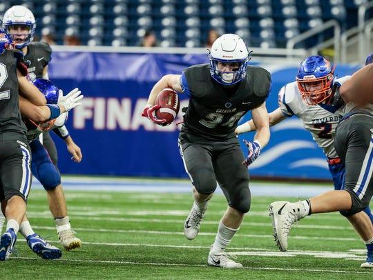 Grand Rapids Catholic Central's Nolan Fugate (24) runs