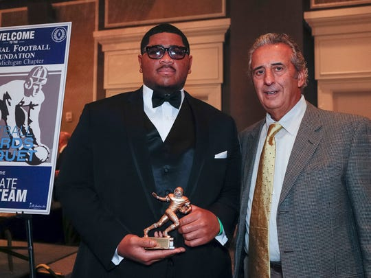 Detroit Free Press 2017 All-State Dream Team member Tyrone Sampson poses with N.F.F. State of Michigan Chapter president Tony Versaci during the National Football Foundation State of Michigan Chapter awards banquet at the Dearborn Inn on Dec. 10, 2017.