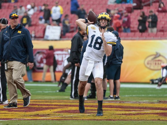 Michigan Wolverines quarterback Brandon Peters warms up for the Outback Bowl at Raymond James Stadium in Tampa, Fla., Monday, Jan. 1, 2018.