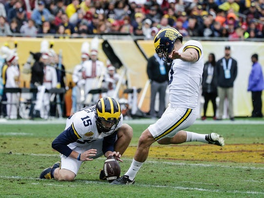 Michigan Wolverines kicker Quinn Nordin attempts a