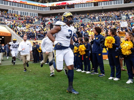 Michigan Wolverines defensive end Rashan Gray runs onto the field before the Outback Bowl against South Carolina at Raymond James Stadium in Tampa, Fla., Monday, Jan. 1, 2018.