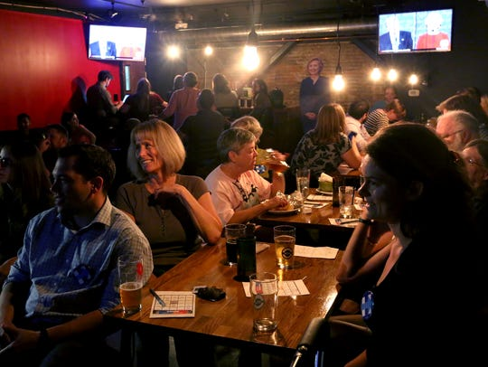 People gather for a watch party of the presidential