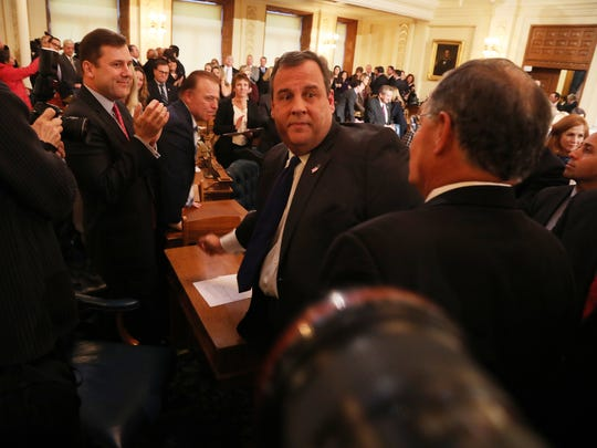 Sens. Joe Pennacchio and Tom Kean Jr. and Assembly Minority Leader Jon Bramnick with Christie as he exits the Assembly chambers after his Jan. 9 address.