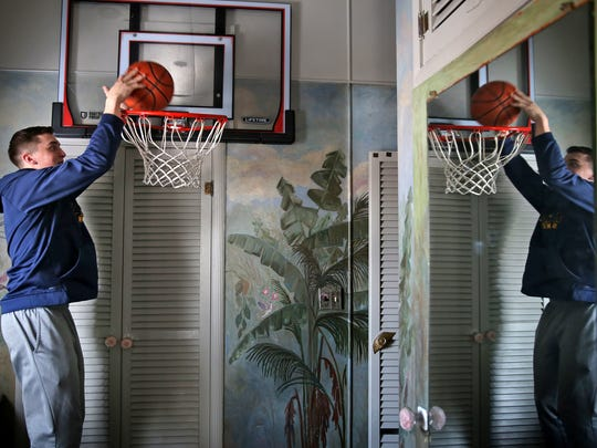 Hayden Langkabel has spent many an hour shooting hoops in his bedroom basketball hoop, at his Morristown, IN home, Tuesday, Jan. 16, 2018.  Hayden is the highest scoring player on the Morristown Jr./Sr. High School's Class A state-ranked team.  He's fifth high scorer in the state.
