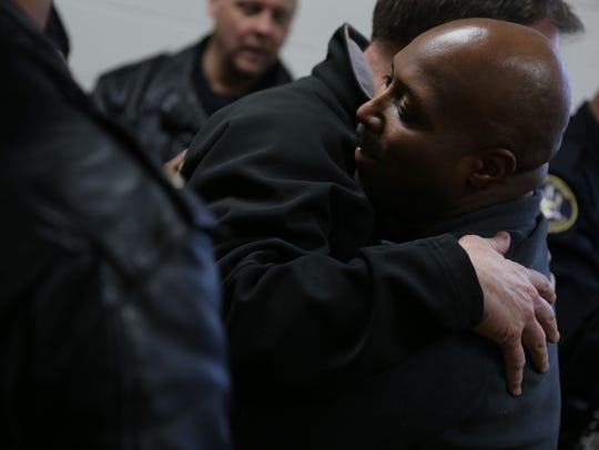 Detroit Police Officer Glenn Doss gets hugs of support