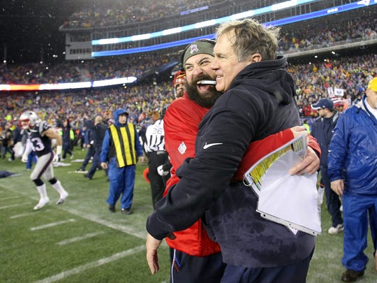 Matt Patricia, left, and Bill Belichick celebrate the Patriots' win over the Colts in the 2015 AFC Championship Game at Gillette Stadium on Jan. 18, 2015 in Foxboro, Mass.