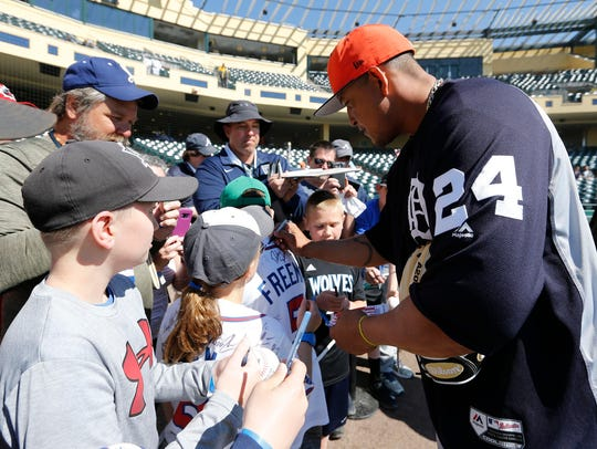 Miguel Cabrera signs autographs this spring.
