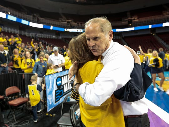 John Beilein hugs his wife, Kathleen, after defeating Houston, 64-63, in the NCAA tournament second round.