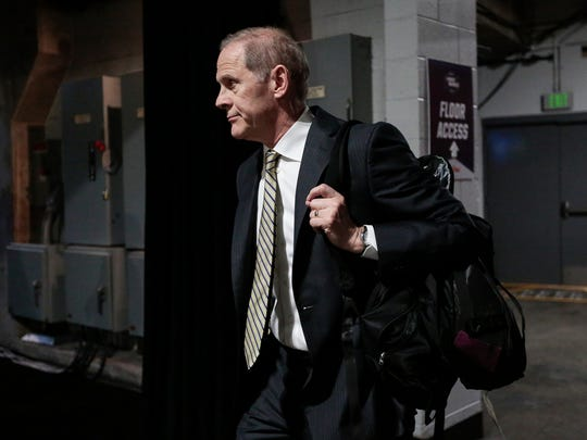 Michigan coach John Beilein arrives at the Staples