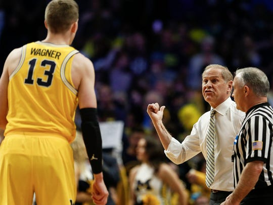 Michigan coach John Beilein talks to forward Moritz Wagner during first half of the Elite Eight against Florida State in the NCAA tournament at Staples Center in Los Angeles on Saturday, March 24, 2018.