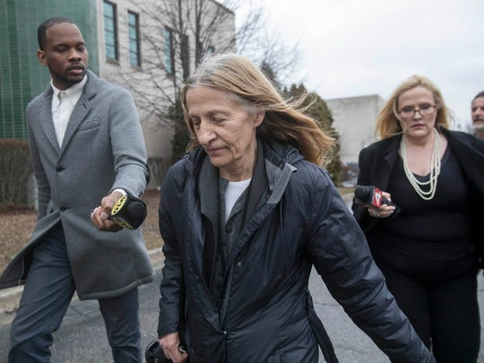 Karen Spranger exits the Talmer building in Mount Clemens last March 27 after a judge removed her from office as the Macomb County clerk/register of deeds.