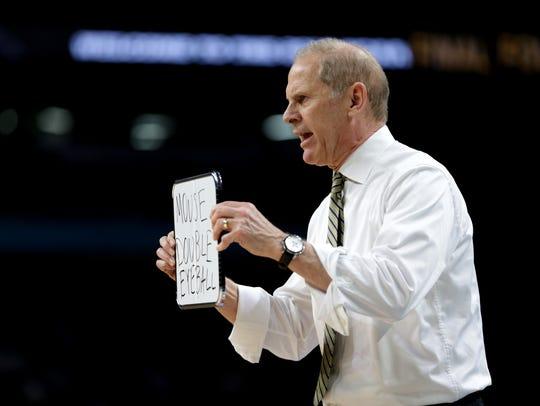 Michigan coach John Beilein instructs his team during