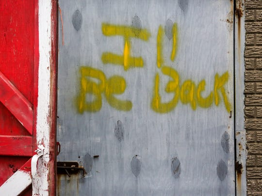 """I'll be back,"" is spray painted on the outside of the stables at Hazel Park Raceway, seen on Wednesday, April 12, 2018."