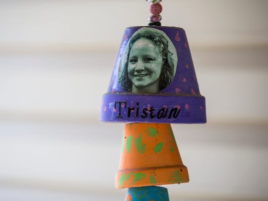 A photo of Tristan Hackman is seen on a wind chime outside her parents Tammy and Bret Hackman's Indianapolis home, Thursday, April 12, 2018. When Bryce's mother Tristan Hackman died of a drug overdose in 2015, several of her organs were donated. Knowing her donation saved others' lives has helped her family heal.