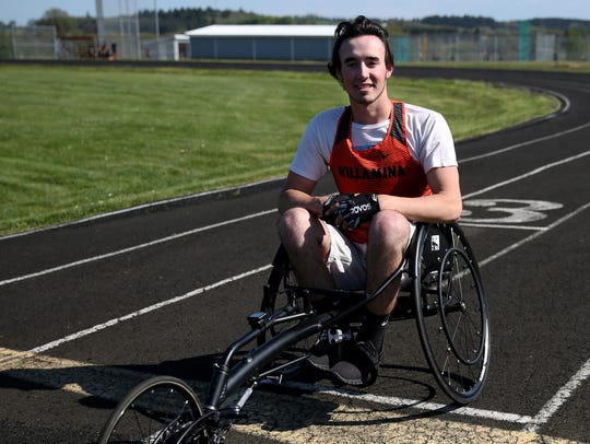 Owen Baker sits in his racing chair during track practice at Willamina High School on April 26, 2018.