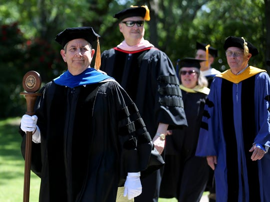 Faculty lead the procession during the Willamette University