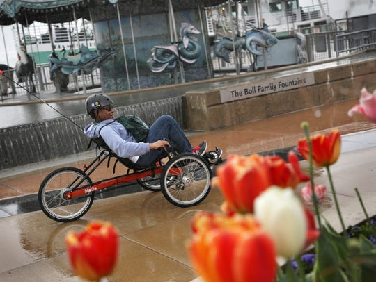 Stephanie Davis rides a recumbent tricycle on the Detroit
