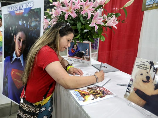 Errin Stegich-Moloney, 38, signs a memory book at Margo