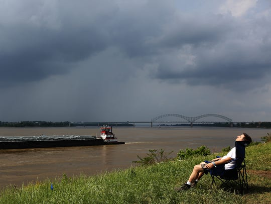 A person lounges at Tom Lee Park during the annual World Championship Barbeque Cooking Contest on May 18.