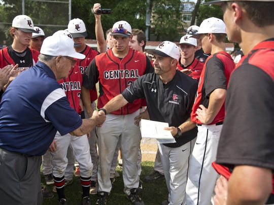 Hunterdon Central head coach Mike Raymond (right) is congratulated after Hunterdon Central defeated Morristown in the NJSIAA Group IV final on June 11, 2016. Raymond, named athletic director at the school after the championship, is now suing the school district because his contract as athletic director was not renewed last spring.