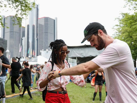 Hannah Marshall, center, and Fritz Pfaff, both of Detroit, dance on the lawn near Red Bull Music stage as artist Black Noise performs during Movement Electronic Music Festival at Hart Plaza in Detroit, Saturday, May 26, 2018.