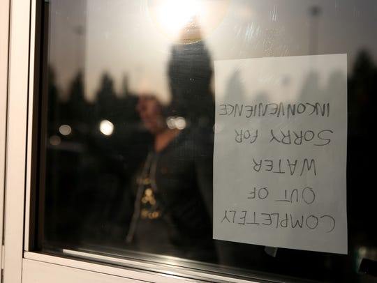 A sign is posted on the doors of the WinCo Foods on
