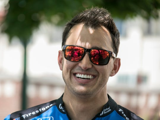 IndyCar racer Graham Rahal is interviews before the