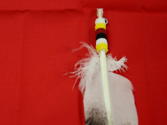 A beaded eagle feather given out during the Eagle Feather ceremony for graduating seniors in the Salem-Keizer Public Schools Indian Education Program at McNary High School in Keizer on Wednesday, May 30, 2018.