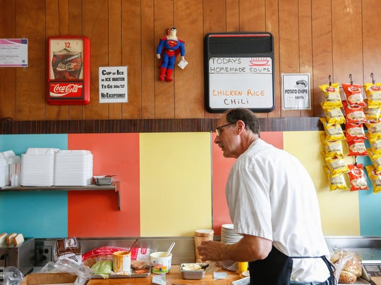 Stuart Litt, owner of Hygrade Deli in Corktown, Detroit, prepares food on Tuesday, June 12, 2018.