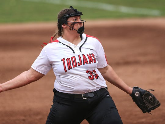 Center Grove Trojans Abby Herbst (33) pitches during