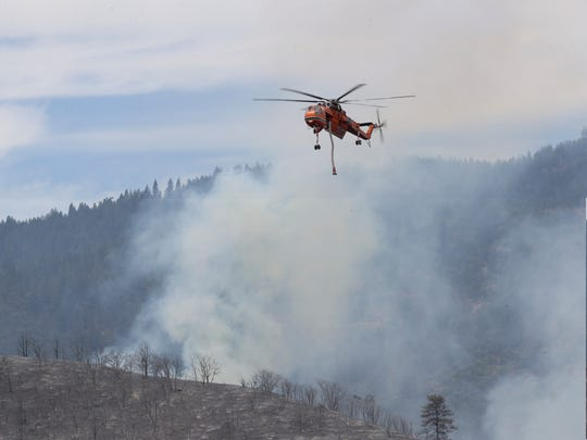 A helicopter is seen Friday, July 6, 2018 over the Klamathon Fire in the California-Oregon border.
