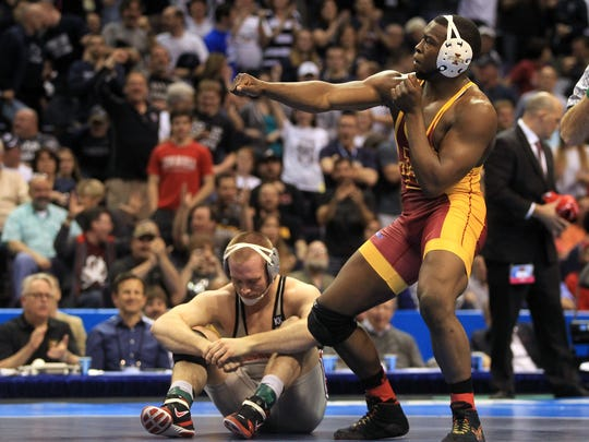 Iowa State senior Kyven Gadson celebrates his pin of Ohio State's Kyle Snyder in the 197-pound final of the NCAA Wrestling Championships.