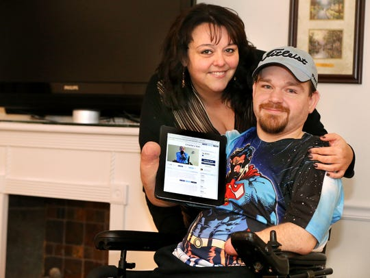 Amanda Rogers, left, stands next to her brother Charlie