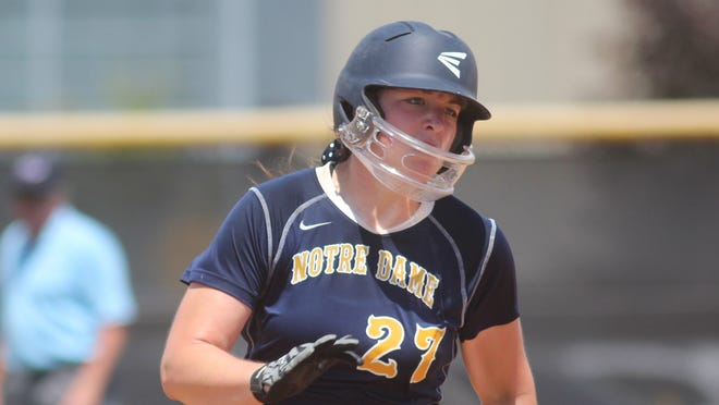 Notre Dame sophomore Haylee Smith heads to third base after hitting a triple. Notre Dame beat Conner 3-2 in the 9th Region softball final June 2, 2013 at NKU.