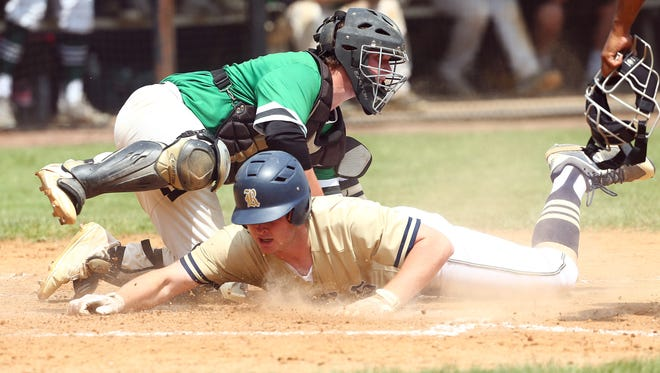 Roxbury's Will Findlay is tagged out at home by Pascack Valley catcher Austin Piorkowski in Friday's North 1, Group 3 baseball final.