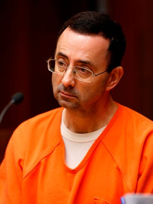 Former Michigan State University and USA Gymnastics doctor Larry Nassar, shown in June, will enter his first plea Wednesday.
