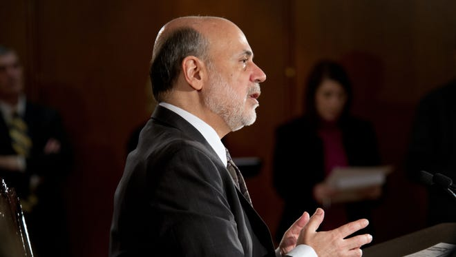 Federal Reserve Board Chairman Ben Bernanke speaks during a news conference after a Federal Open Market Committee (FOMC) meeting Dec. 18, 2013, at the Federal Reserve in Washington, D.C. The Federal Reserve announced that it was scaling back its U.S. Treasury bonds and mortgage-backed securities buying program to $75 billion each month.