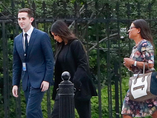 Kim Kardashian West appears with attorney Shawn Chapman Holley at the White House on Wednesday.