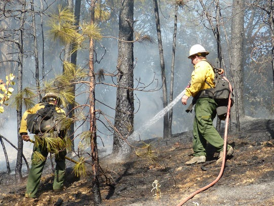The fire off Interstate 5 near Shasta Caverns Road scorched an estimated half-acre of land.