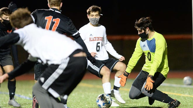 Stoughton goalkeeper Nolan Gerome makes the saves on Oliver Ames' Mathias Taylor during their game on Monday, Nov. 1, 2020.