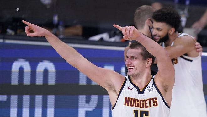 Denver Nuggets center Nikola Jokic (15) celebrates a win over the Los Angeles Clippers on Tuesday in Lake Buena Vista, Fla.