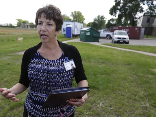 Su van Houwelingen, executive director of Oshkosh/Winnebago County Housing Authority, talks about the Cumberland Court project on September 15.  The Cumberland Court apartments is undergoing a $14 million renovation to the existing buildings along with a new community center.