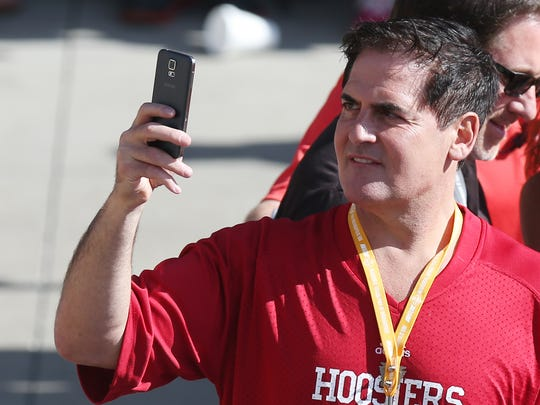 Businessman Mark Cuban takes in the scene on the red carpet before the 98th Indianapolis 500 race at the Indianapolis Motor Speedway Sunday, May 25, 2014.
