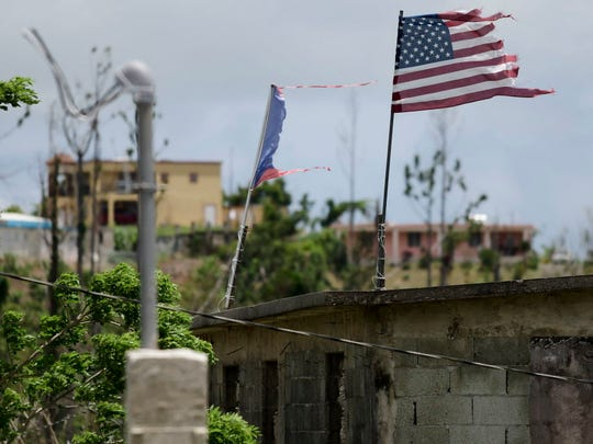 Deteriorated U.S. and Puerto Rico flags near Yabucoa